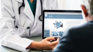 Doctor showing person information on laptop