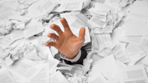 Hand covered in documents