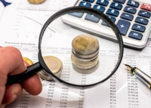 Magnifying glass and coins